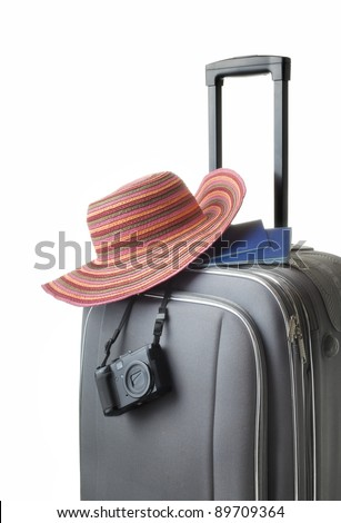 travel concept isolated suitcase with accessories - stock photo