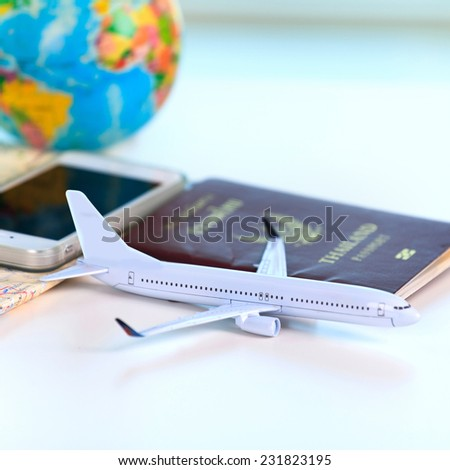 Travel concept. Passports, phone and airplane