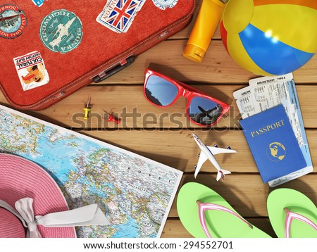 Travel concept. Snglasses, world map, beach shoes, sunscreen, passport, planeickets, beach ball, hat and old red suitcase for travel on the wood background. - stock photo