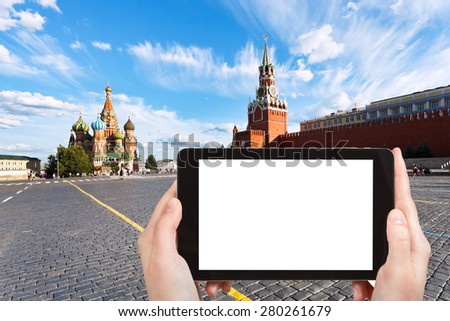 travel concept - tourist photograph Red Square with Saint Basil Cathedral and Spasskaya Tower in Moscow, Russia on tablet pc with cut out screen with blank place for advertising logo - stock photo