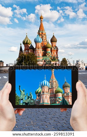 travel concept - tourist taking photo of Pokrovsky cathedral on Red square in Moscow on mobile gadget, Russia - stock photo