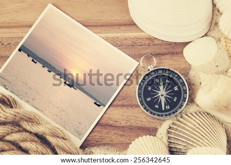 Travel concept, travel items on wooden background - stock photo