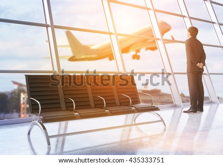 Travel concept with businessman looking out of window in airport interior with city view, sunlight and a plane flying by. 3D Rendering - stock photo