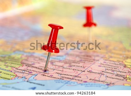 Travel concept with red pushpin - stock photo