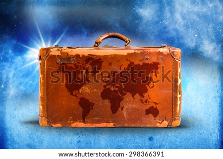 Travel concept, world map over vintage suitcase located on stairway background - stock photo