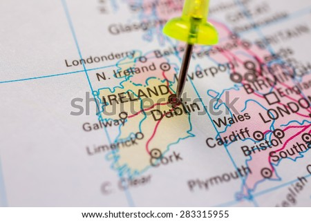 travel destination, pin on the map. Ireland on atlas world map - stock photo