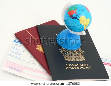 travel documents and globe - stock photo