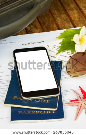 travel documents with black smartphone, copy space on screen - stock photo