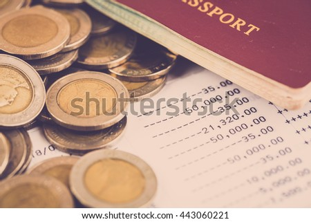Travel expense concept. Bank account and pass port with coin. vintage filter.