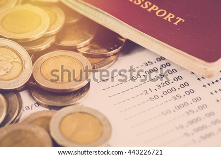 Travel expense concept. Bank account and pass port with money coin. Vintage filter