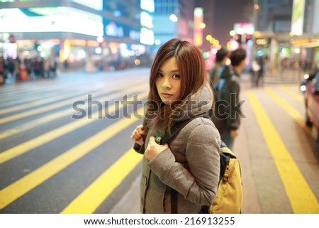 travel girl lost in city, standing in the road - stock photo