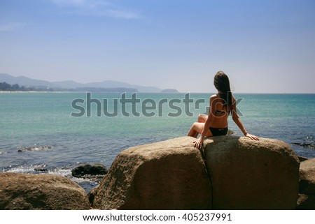 Travel girl on the stones, ocean white girl, beach girl, back girl