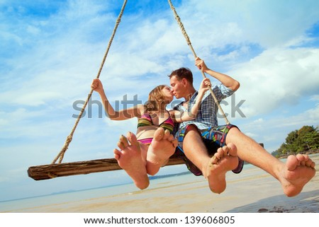 travel, happy loving couple on the beach - stock photo