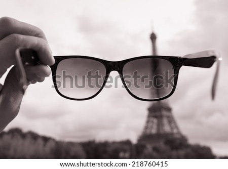 Travel, holiday concept - Eiffel tower through the sunglasses