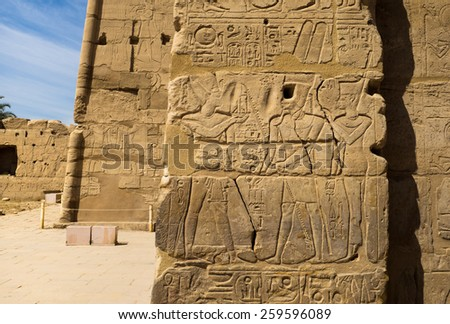 Travel in Luxor, famous Egyptian landmarks. Ancient Egypt art objects in Karnak Temple.  Mythological story on temple wall - Amun-Ra, Osiris and egyptian hieroglyphs. - stock photo