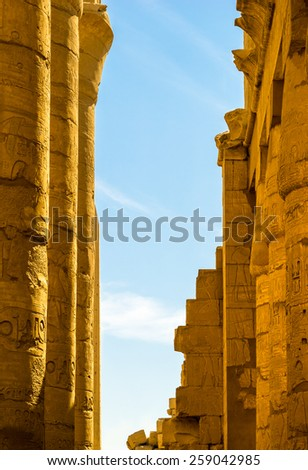 Travel in Luxor, famous Egyptian  landmarks. Ancient Egypt columns in Karnak Temple. Hypostyle hall of the old Karnak temple.  - stock photo