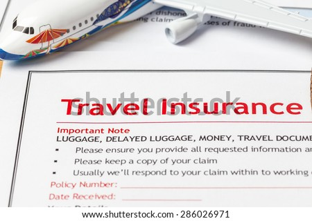 Travel Insurance Claim application form on brown envelope, business insurance and risk concept; document and plane is mock-up - stock photo