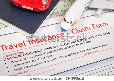 Travel Insurance Claim application form on table, business and risk concept; document,car and plane is mock-up - stock photo