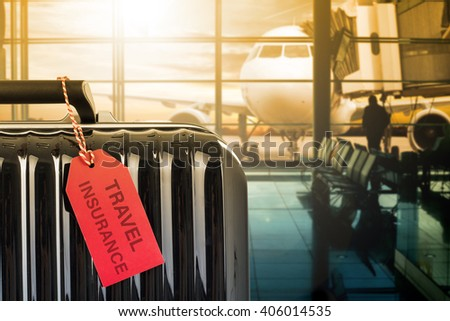 Travel insurance suitcase with tag paper for protection your trip. - stock photo
