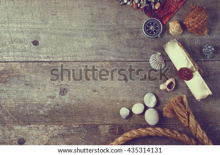 Travel items on wooden table. Summer time sea vacation background. Top view with copy space - stock photo