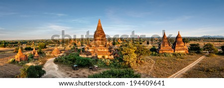 Travel landscapes and destinations panorama view. Tourists horse carriage in front of ancient Mahazedi Pagoda. Amazing architecture of old Buddhist Temples at Bagan Kingdom, Myanmar (Burma) - stock photo