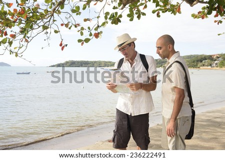 Travel: Lost tourists with map - stock photo