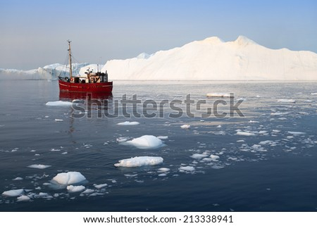 Travel on a research vessel among polar icebergs. Studying of a phenomenon of global warming. Catastrophic thawing of ices of polar regions. - stock photo