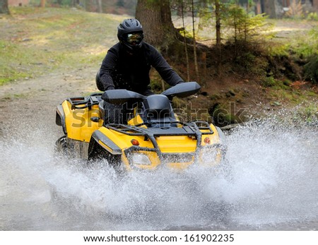 Travel on ATVs in river - stock photo