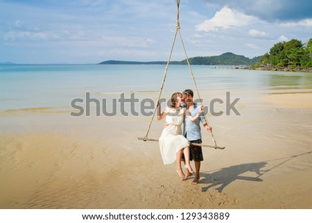 travel or honeymoon, wedding couple on the beach - stock photo