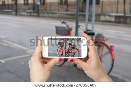 Travel photo on the phone, photo bicycle parked at the post - stock photo