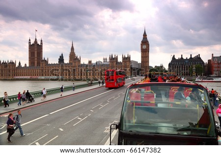 Travel red double-decker buses on Westminster bridge in London - stock photo