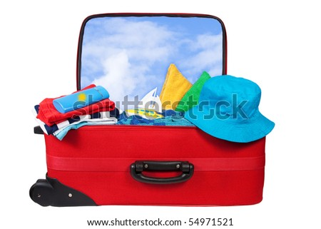 Travel red suitcase. Packed for vacation in sea resort. Personal belongings: hat, cream, towel. Isolated on white - stock photo