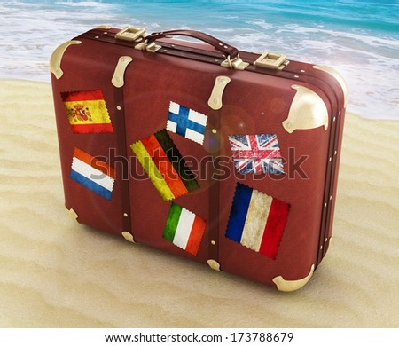 travel suitcase on the beach  - stock photo
