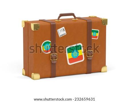 Travel suitcase with flag of ethiopia isolated on white - stock photo
