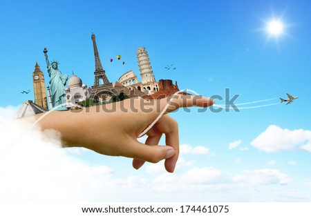 Travel the world hand monuments concept - stock photo