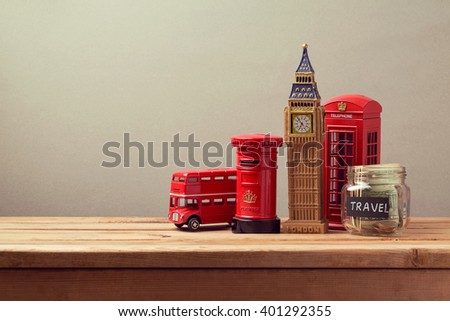 Travel to Great Britain concept with souvenirs and money box jar. Planning summer vacation, money budget trip concept. - stock photo