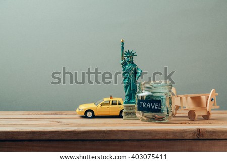 Travel to New York, USA concept with Statue of Liberty souvenir. Planning summer vacation, money budget trip concept. - stock photo