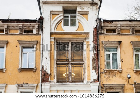 travel to Russia - shabby urban house of traditional Moscow architecture of the early 20th century on Chaplygin Street in Moscow city in winter