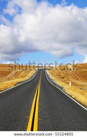 Travel to steppes of California on excellent American highway - stock photo