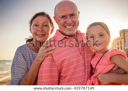 travel to the beach with grandparents - stock photo