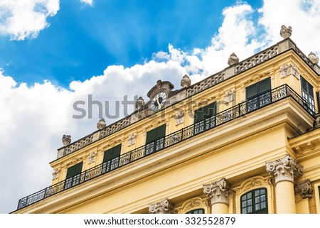 travel to Vienna city - facade of Schloss Schonbrunn palace and white cloud in blue sky, Vienna, Austria - stock photo