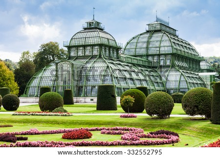 travel to Vienna city - Palm House, large greenhouse in garden of Schloss Schonbrunn palace, Vienna, Austria - stock photo