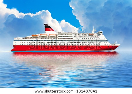 Travel, tourism and tropical resort concept: big red cruise ship or liner in blue sea or ocean with clouds - stock photo