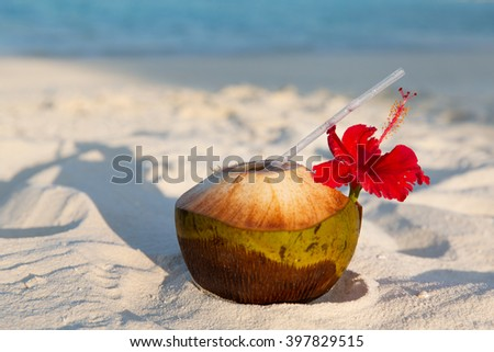 travel, tourism, vacation and summer holidays concept - coconut drink on exotic tropical maldives beach - stock photo