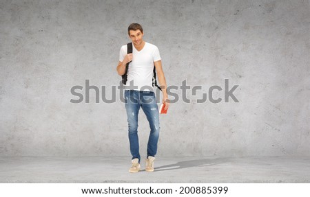 travel, vacation and education concept - smiling student with backpack and travel guide - stock photo