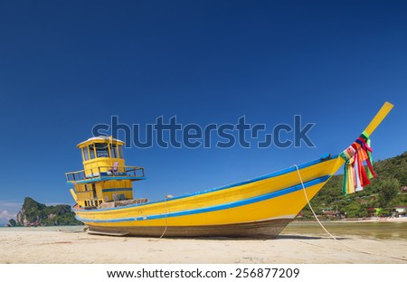 Travel vacation background - beautiful beach with colorful sky and boat, Thailand