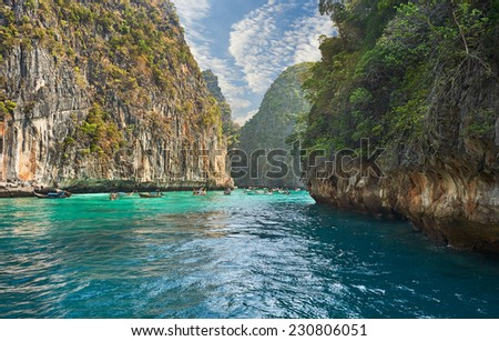 Travel vacation background - Tropical island with resorts - Phi-Phi island, Krabi Province, ThailandBuddhist and Hindu motifs. - stock photo