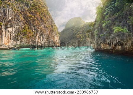 Travel vacation background - Tropical island with resorts - Phi-Phi island, Krabi Province, ThailandBuddhist and Hindu motifs. - stock photo