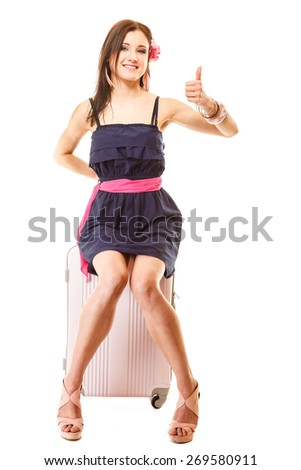 Travel vacation concept. fashion woman in voyage, girl in full length with pink suitcase luggage bag making thumb up gesture - stock photo