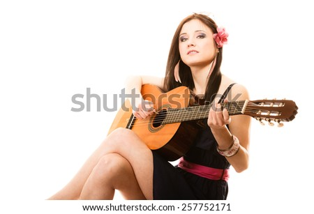 Travel vacation concept. Music lover summer girl playing acoustic guitar isolated on white background